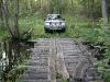 Tilts pār upīti. Dēļi pa vidu paredzēti zirgiem